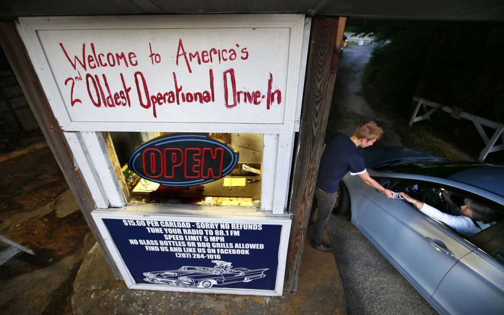 A customer stops at the box office at the Saco Drive-In in Saco. The number of  drive-ins has been declining steadily for years. The Saco Drive-in claims to be the second oldest still operating in the U.S.