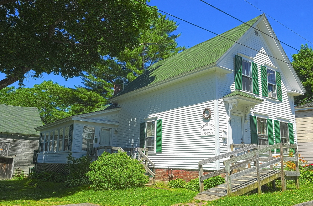 The town of Winthrop is suing Karen Burke, the owner of 20 Green St., about improvements she made to the basement. The town says she did not have the proper permits to do the work.