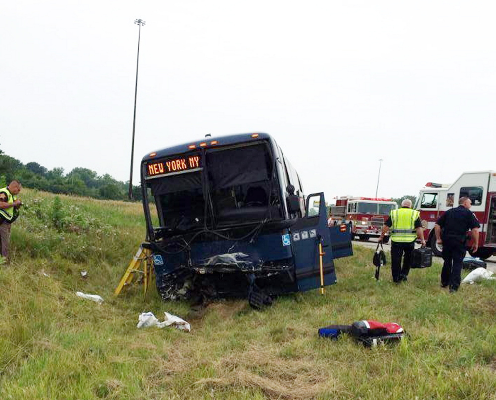 Emergency personnel respond to the scene of a bus accident on Sunday on interstate 70 near Richmond, Ind.