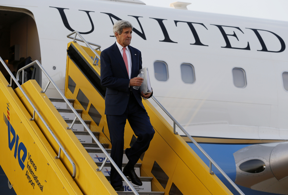 U.S. Secretary of State John Kerry steps out his plane upon arrival at Vienna International Airport for talks with foreign ministers from the six nations negotiating with Tehran on its nuclear program in  Vienna, Sunday.