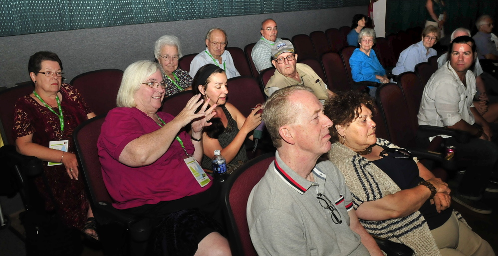 """Movie fan Patricia Clark, of Unity, asks actress Glenn Close a question Sunday after a screening of the movie """"Dangerous Liaisons"""" at Railroad Square Cinema in Waterville. Close received the Mid-Life Achievement award that evening during the Maine International Film Festival."""