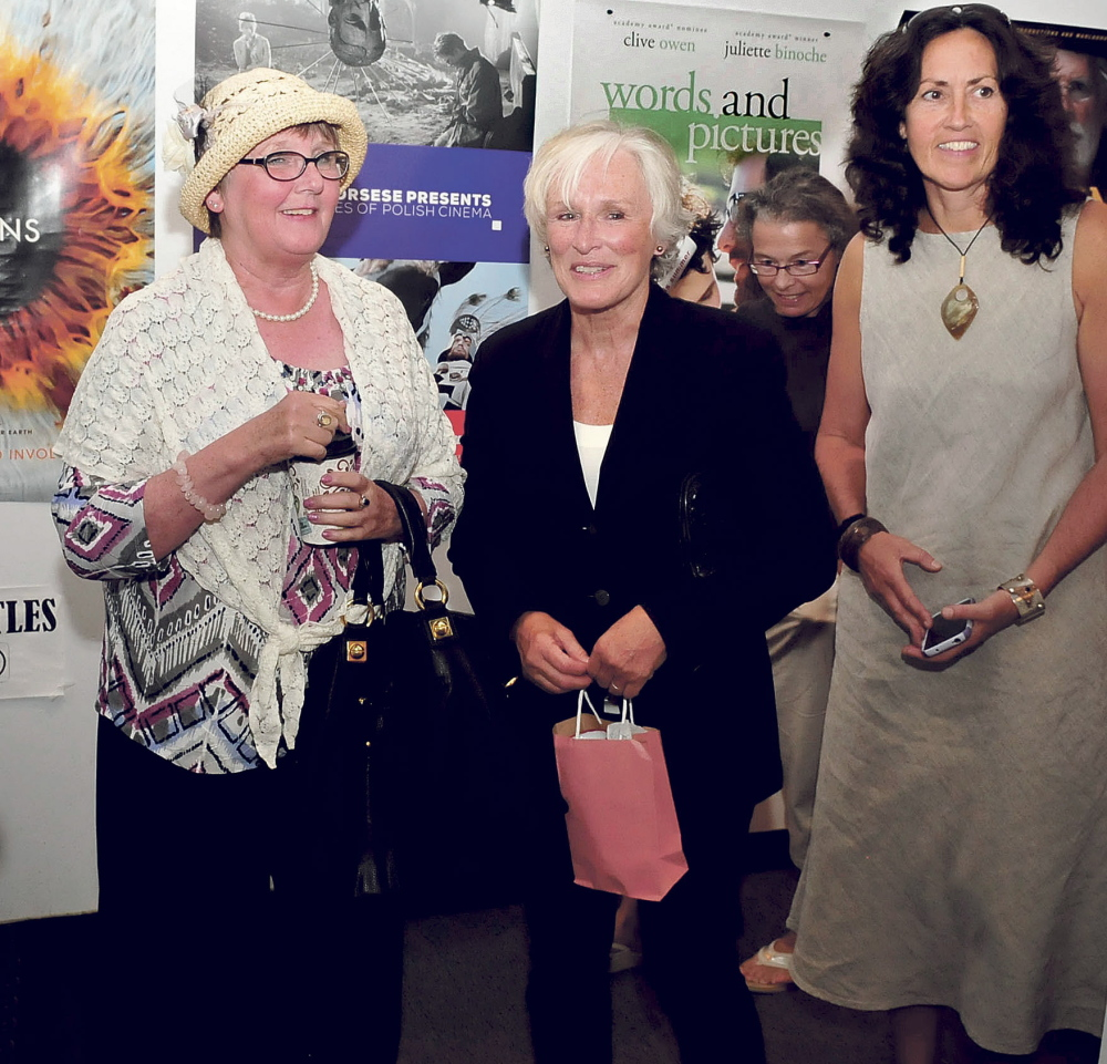 Actress Glenn Close, center, is escorted by Cheryl McKenney, left, and Arleen King-Lovelace on Sunday after speaking with movie fans at Railroad Square Cinema in Waterville. Close received the Maine International Film Festival's Mid-Life Achievement award.