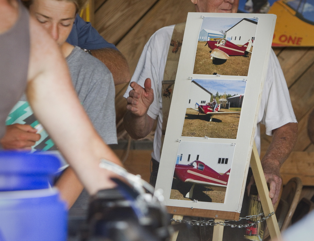 Photographs of Clarke Tate and the plane he was flying in during Saturday's fatal crash are displayed Sunday at Sprague Field in Cape Elizabeth.