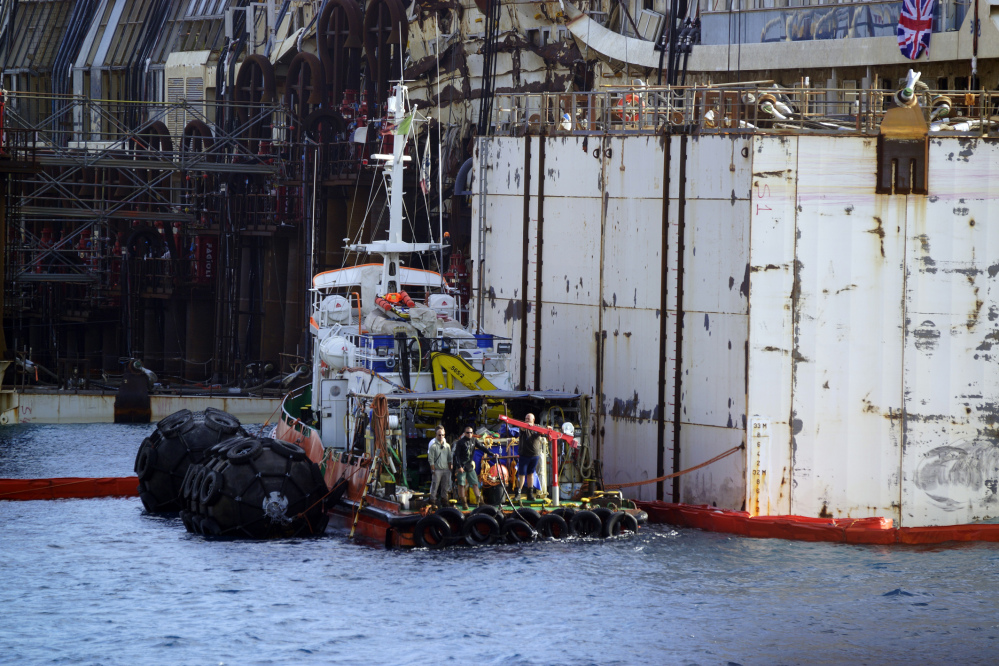 Authorities expressed satisfaction that the operation to float the Concordia from an underwater platform had proceeded without a hitch early Monday. The cruise liner struck a reef in January 2012 and capsized, killing 32 people.