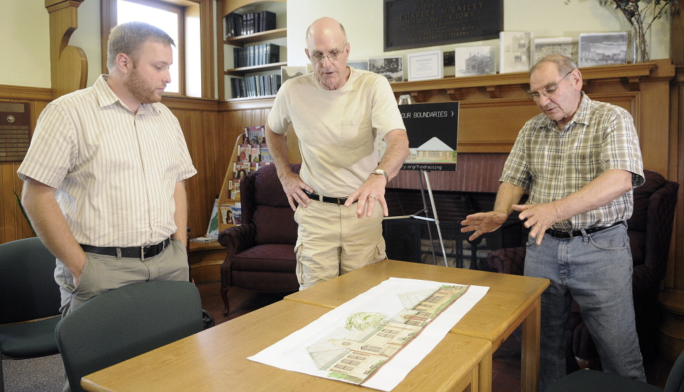 Charles M. Bailey Library architect Phil Locashio, right, steering committee member Dale Glidden, center, and librarian Richard Fortin discuss plans for the facility's expansion while meeting at the library in Winthrop last week.