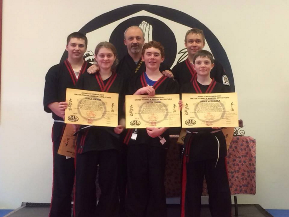 United Fitness in Winthrop has announced its newest junior black belts. Front, from left, are Kiara Simonds, River Coron and Brian McNamara; back, from left, are Devin White, Shihan Ryan Chamberland and Nathan Cram. These students are also all part of the Kosho Leadership team, assisting in classes with the younger martial students, travel to seminars and do extra training to be part of the team.