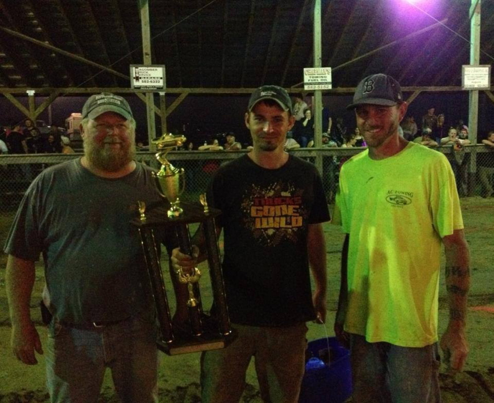 Ron Poore of Gardiner was chosen as the 2014 PowerHouse Winner from the Maine 4x4 Festival that was held at the Pittston Fair. Poore competed and placed in multiple events. This award is voted on by the Pittston Fair Association members. From left are Pete Weeks, vice president of the Pittston Fair Association; Poore; and association member Travis Chiasson.