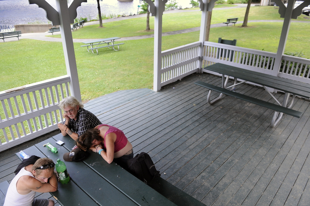 """Joseph McKenna, left, Barry Sheffield and Ann Meserve sit Tuesday in the gazebo on the Kennebec River in Augusta.  Augusta City Councilors meet Thursday to consider allocating $14,000 to fund an increased police presence downtown for the rest of summer. """"It's not against the law to take a nap,"""" Sheffield said.  """"This is someplace to go and watch bald eagles catch fish."""""""