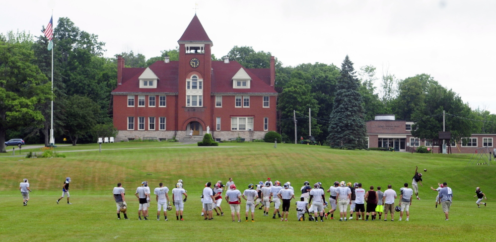 The East team practices before media day at the Lobster Bowl on Tuesday at Hebron Academy.