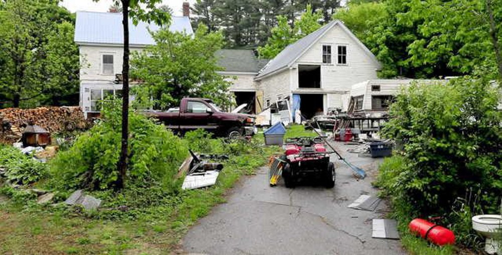 Photograph taken in June showing debris on the property of Duane Pollis in Wilton. Town officials say Pollis has made progress cleaning up the property and will be encouraged to continue his efforts.