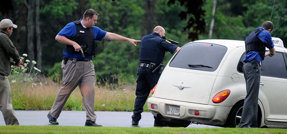 Augusta Police officers surrounded a taxi with guns drawn Wednesday following a traffic stop on Western Avenue in Augusta.