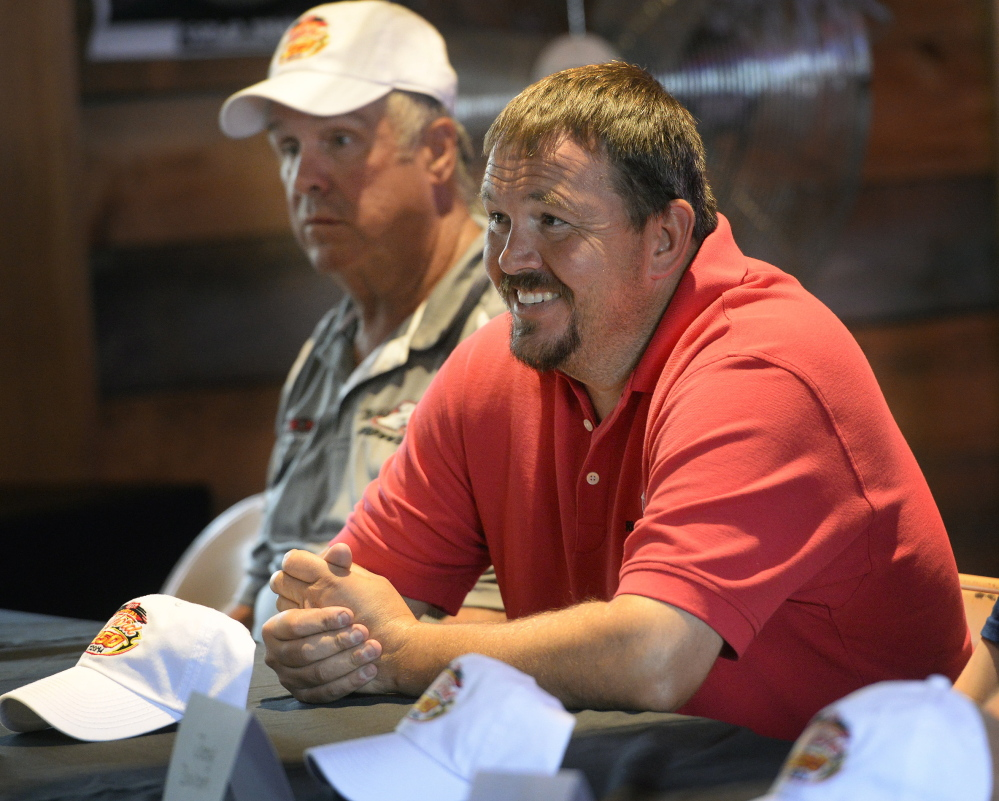 """Ben Rowe smiles as he takes questions during the Oxford 250 media day at Bentley's Saloon in Arundel Wednesday. To the right is Mike Rowe, who said """"We're running good, we're running up front and I see no reason why we can't win this thing."""""""