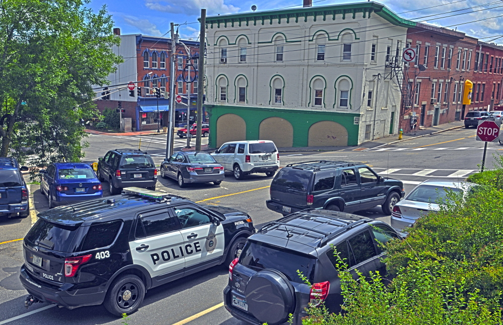 An Augusta police vehicle sits in traffic Thursday at the corner of Commercial and Bridge streets. Downtown business owners want city council to approve more funding to pay for extra patrols in the downtown because of problems with illegal and intimidating behavior by vagrants.