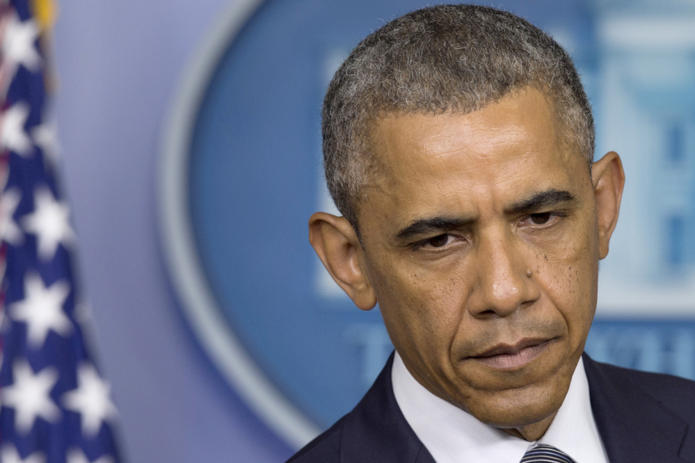 President Barack Obama pauses while speaking about the situation in Ukraine on Friday in the Brady Press Briefing Room of the White House in Washington.