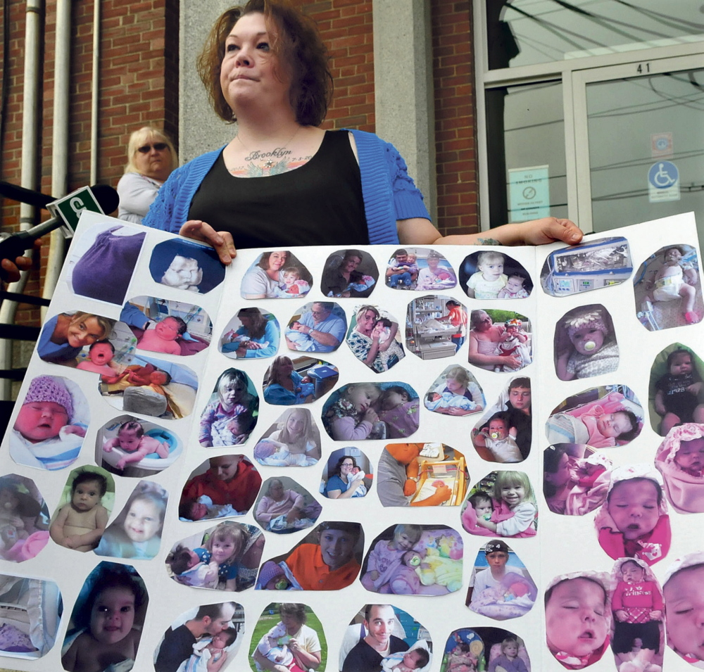 Nicole Greenaway displays pictures of her daughter Brooklyn Foss-Greenaway on the steps of the Somerset Superior Court in Skowhegan in May.