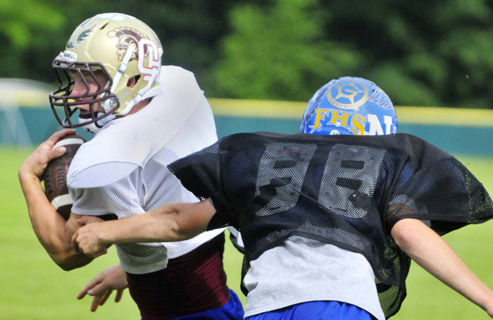 Thornton Academy standout back Andrew Libby runs during Lobster Bowl practice on Tuesday at Hebron Academy. Even rivalry teams come together for the special cause.