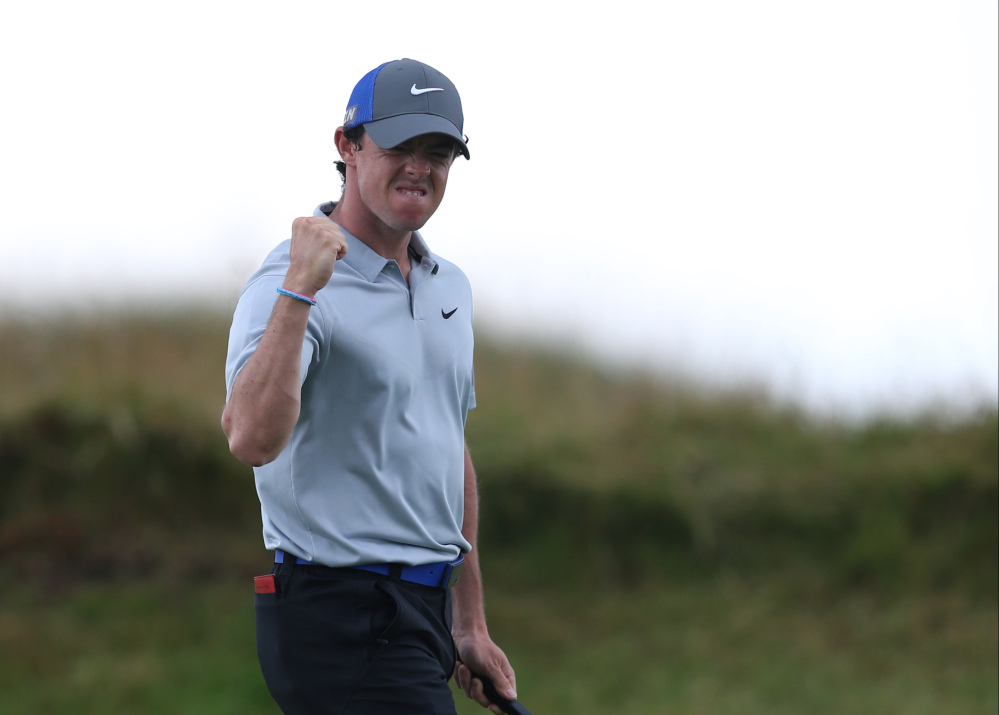 Rory McIlroy celebrates a birdie on the 14th hole during the third round of the British Open on Saturday.
