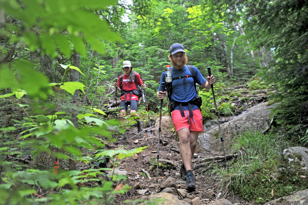 Appalachian Trail thru-hikers Connor Litchman, of Mansfield, Mass., and Jason Hamner, of Tuscaloosa, Ala., hike a section of the Appalachian Trail in Wyman Township. This is the section where Geraldine Largay, 66, was last seen a year ago.