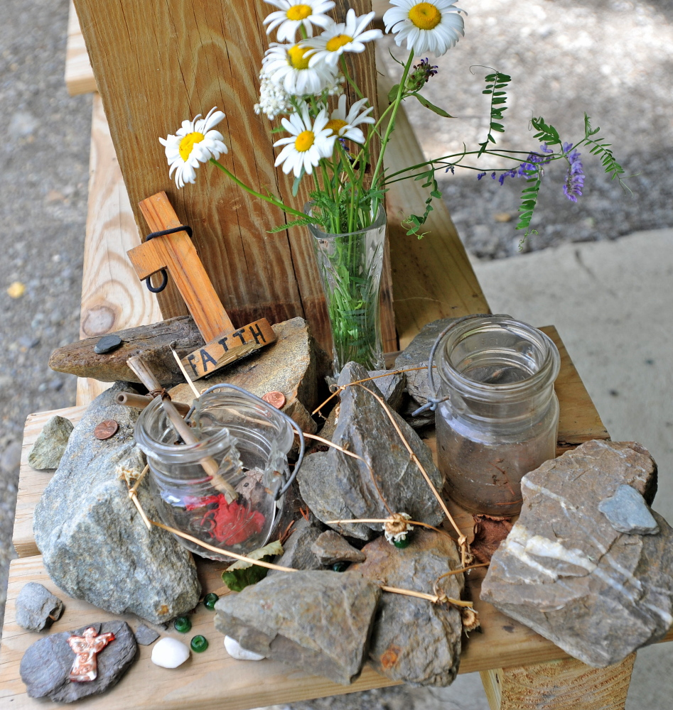 A memorial for missing hiker Geraldine Largay remains at the Appalachian Trail kiosk at the Appalachian Trail crossing on Route 27 in Wyman Township on Wednesday. She was supposed to meet her husband here a year ago, but never arrived.