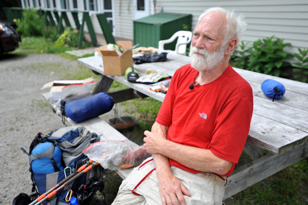 Harold Helm, 70, of Pleasant Hill, Calif., sits outside the Stratton Motel after finishing a section of the Appalachian Trail on Wednesday. Helm, who answers to the trail name Slow Mosey, began hiking sections of the AT in 1972 and plans to finish this summer.