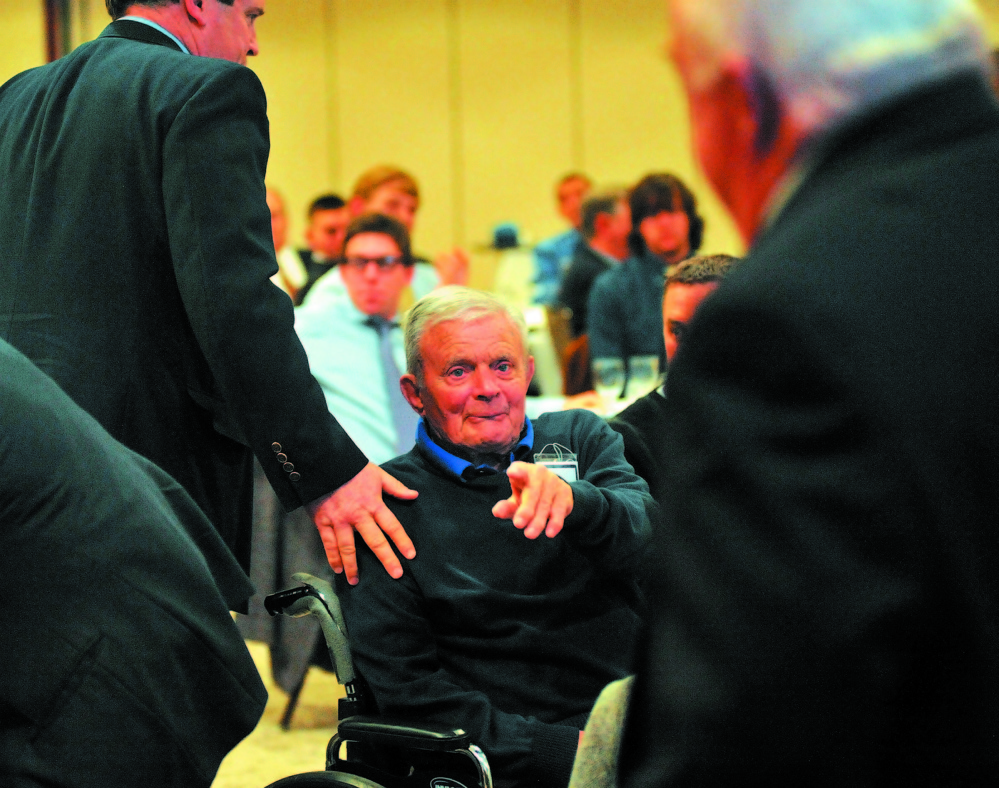 Dr. John Winken points during a ceremony at Colby College in March 2011, when the school retired Winkin's No. 5 jersey. Winkin coached the Colby baseball team for 20 years, winning 229 games. He finished his career with more than 1,000 coaching victories. Winkin died Saturday. He was 94.