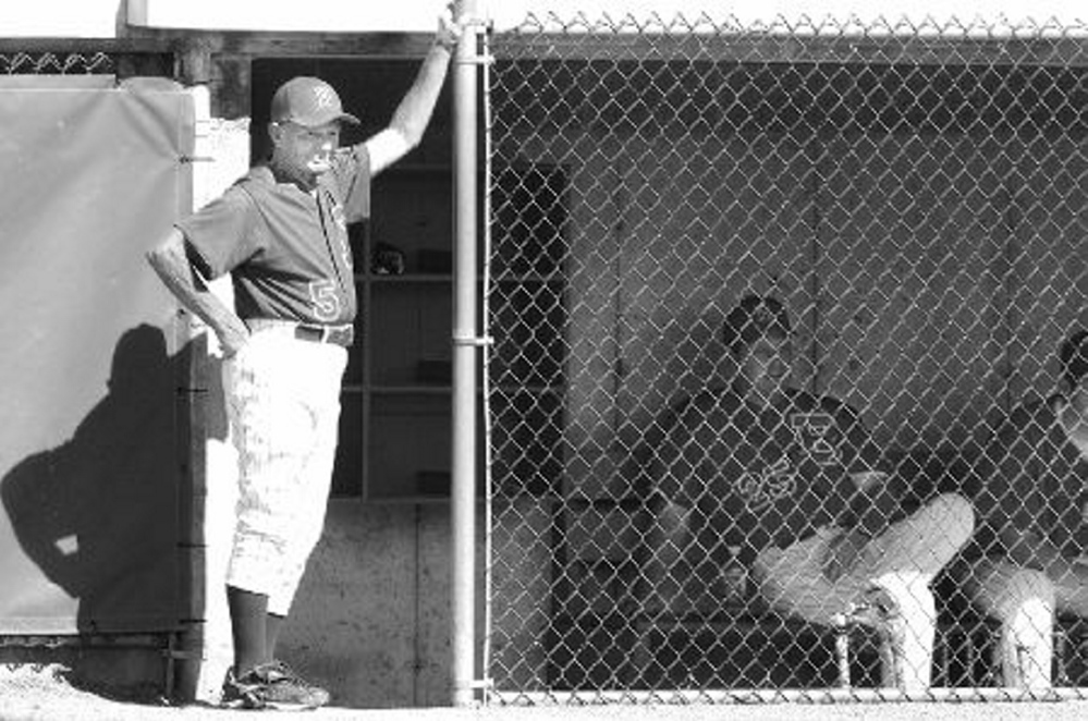 Dr. John Winkin watches his Bangor American Legion team warm up for a 2008 state tournament game against Monmouth. Winkin, 94, died Saturday.