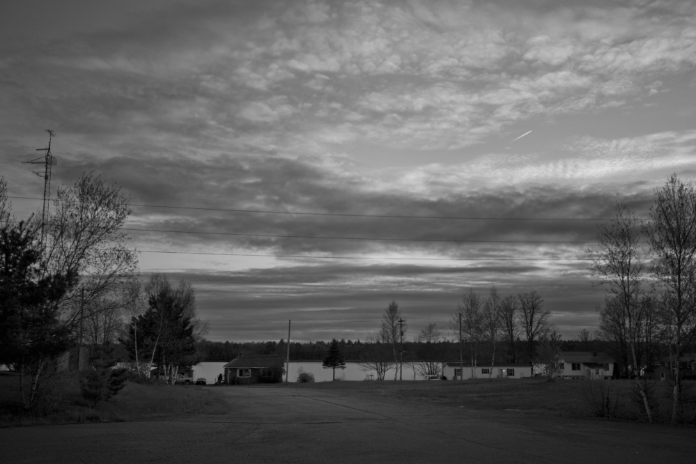 """The sun sets over """"The Strip"""" at the Indian Township Passamaquoddy reservation Wednesday, May 21, 2014."""