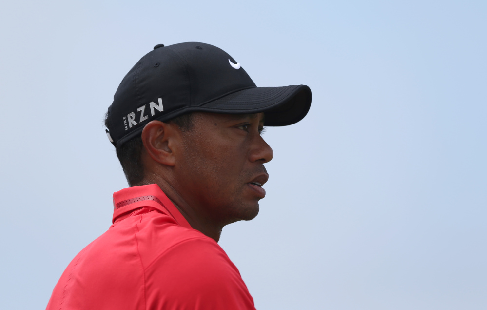 Tiger Woods looks along the 13th fairway during the final round of the British Open on Sunday. Woods finished in 69th place.