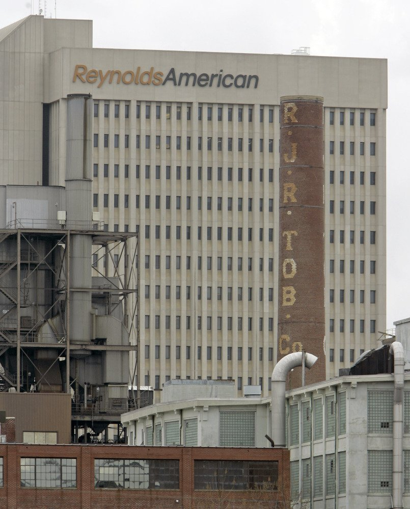 In this Feb. 6, 2008 photo, a smokestack of an old R.J. Reynolds Tobacco plant frames the Reynolds American building in Winston-Salem, N.C., A Florida jury has slammed R.J. Reynolds Tobacco Co. with $23.6 billion in punitive damages in a lawsuit filed by Cynthia Robinson, the widow of a longtime smoker who died of lung cancer in 1996.