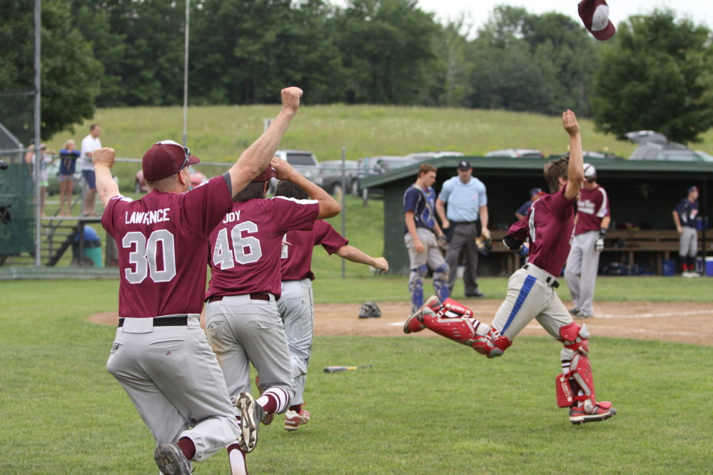 Members of the Central Maine 15-under Babe Ruth team celebrate after they beat Auburn 2-1 to capture the state championship Sunday in Augusta.