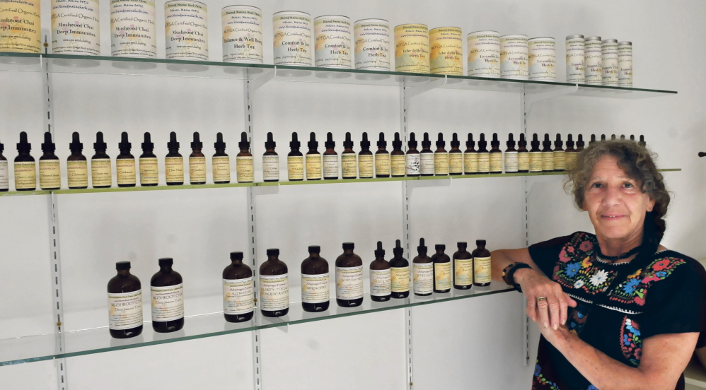 Gail Edwards displays some of the new products Thursday at her expanded Blessed Maine Herb farm in Athens.