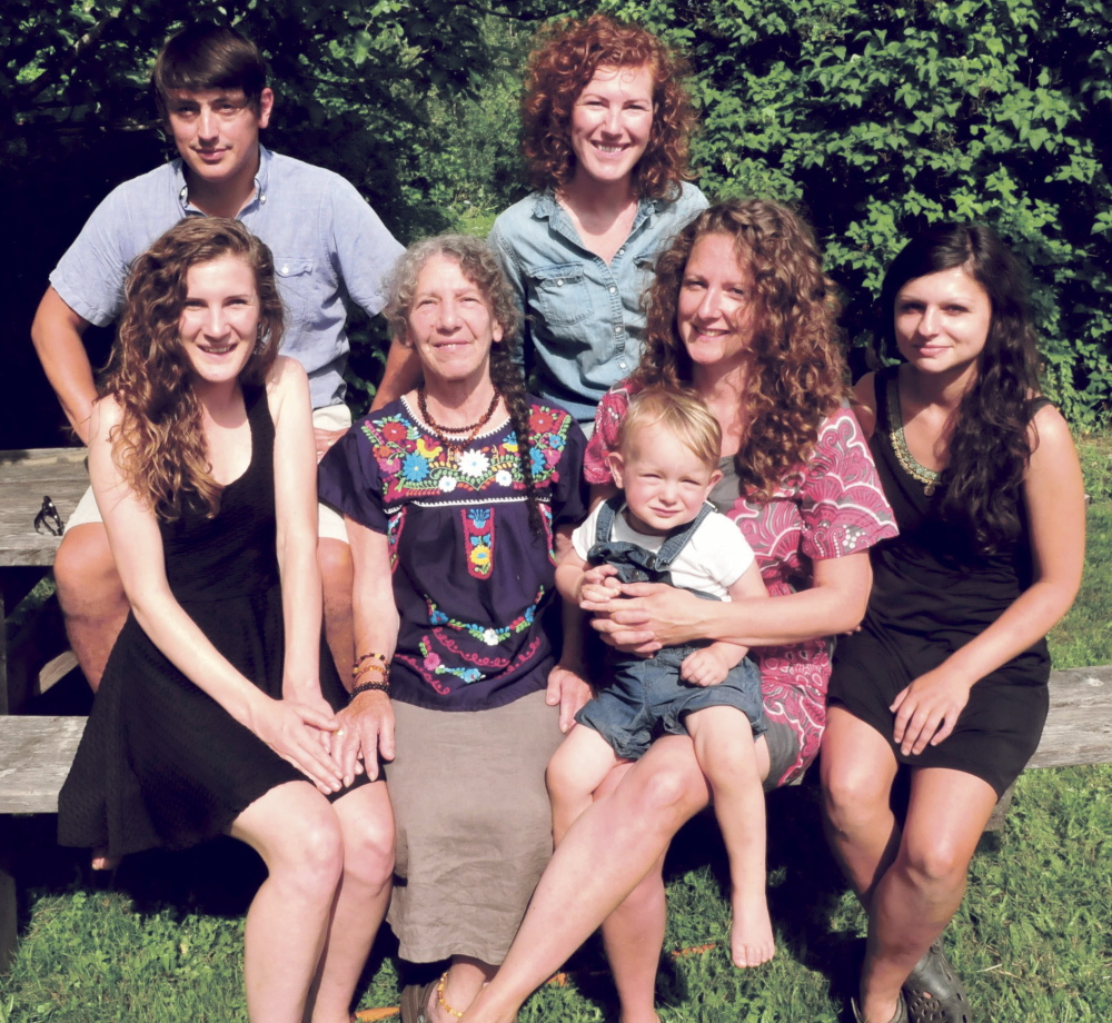 With a lot of help and work from family and friends Gail Edwards, center, and her Blessed Maine Herb farm in Athens has expanded over the years. In back, from left, are Adam Rosario and Gracie Hilmer; in front are Belle Hilmer, Edwards, Rosa Rosario, her son Mariano and her friend Ashley Tart.