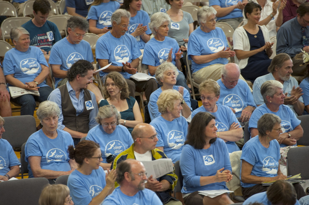 Citizens in favor of the ban to keep tar sand oil from entering the harbor in South Portland wear blue shirts to show their support during the South Portland City Council on Monday. Logan Werlinger/Staff Photographer