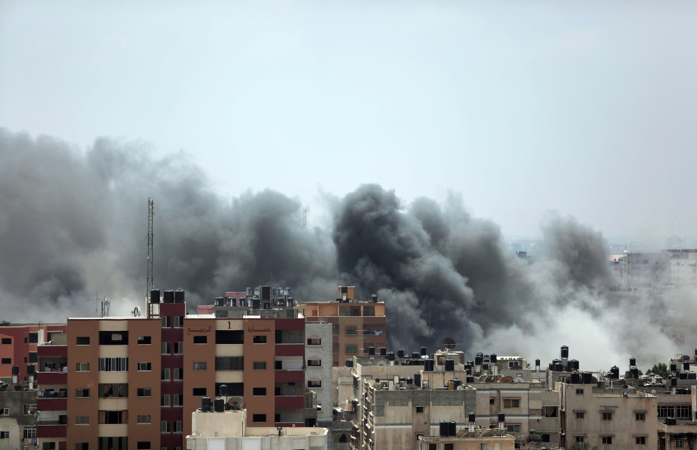 Smoke rises after an Israeli missile strike hit Gaza City on Monday. On Sunday, the first major ground battle in two weeks of Israel-Hamas fighting exacted a steep price, killing scores of Palestinians and over a dozen Israeli soldiers and forcing thousands of terrified Palestinian civilians to flee their devastated Shijaiyah neighborhood, which Israel says is a major source for rocket fire against its civilians.