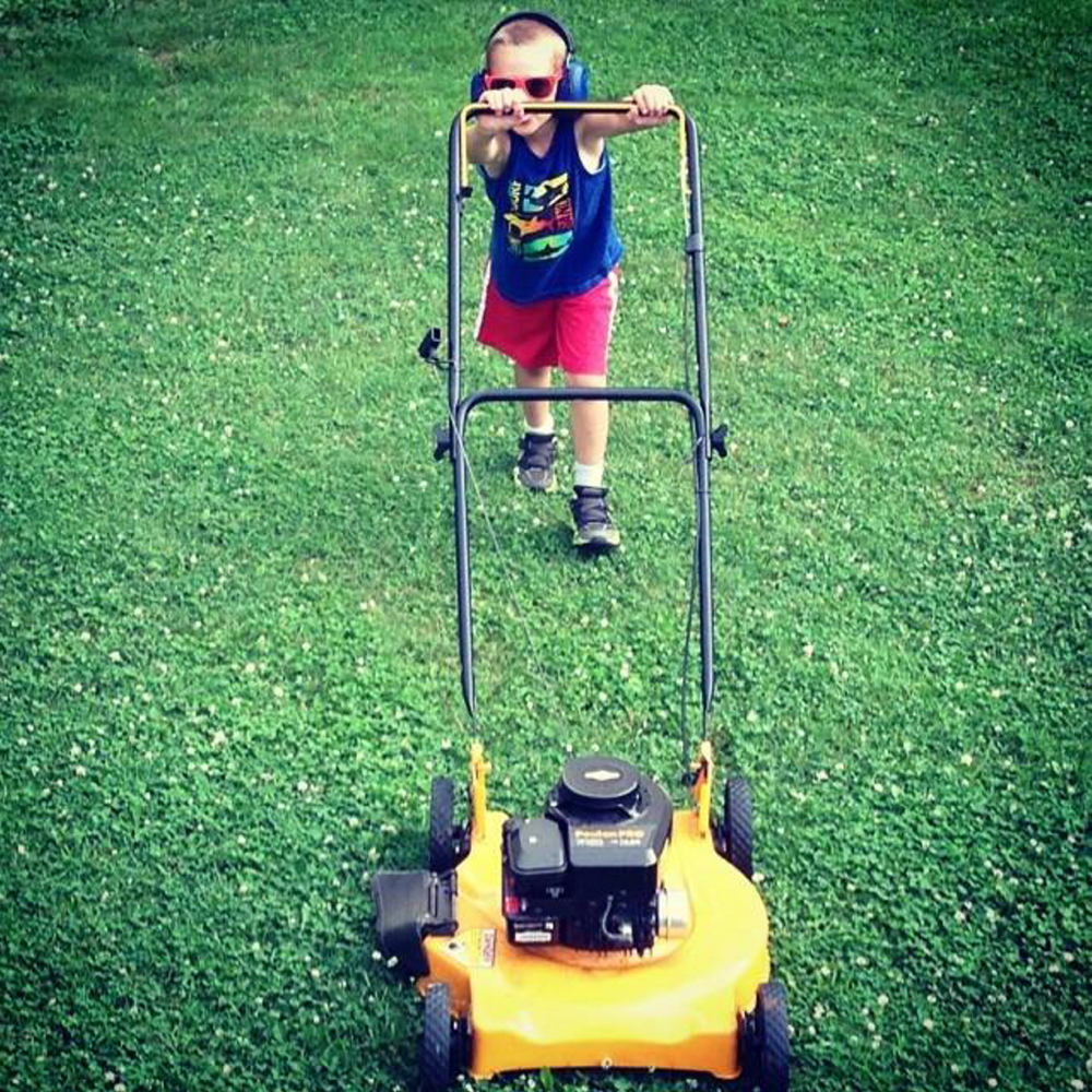 Photo courtesy of Heather Blanchet   Gage Blanchet, 6, practices mowing the lawn at his home in Canaan. The mower was not running.