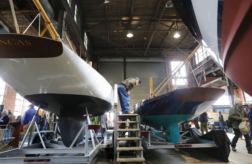 A boat enthusiast gets a close-up view of a boat during a boatbuilders show in Portland. Sales of pleasure craft have increased.
