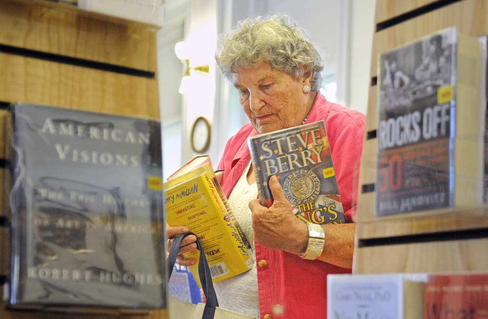 Randolph resident Shirley Hanley selects books Monday at the Gardiner Public Library. Randolph residents will decide at Town Meeting on Wednesday whether the town should end its relationship with the Gardiner Public Library.