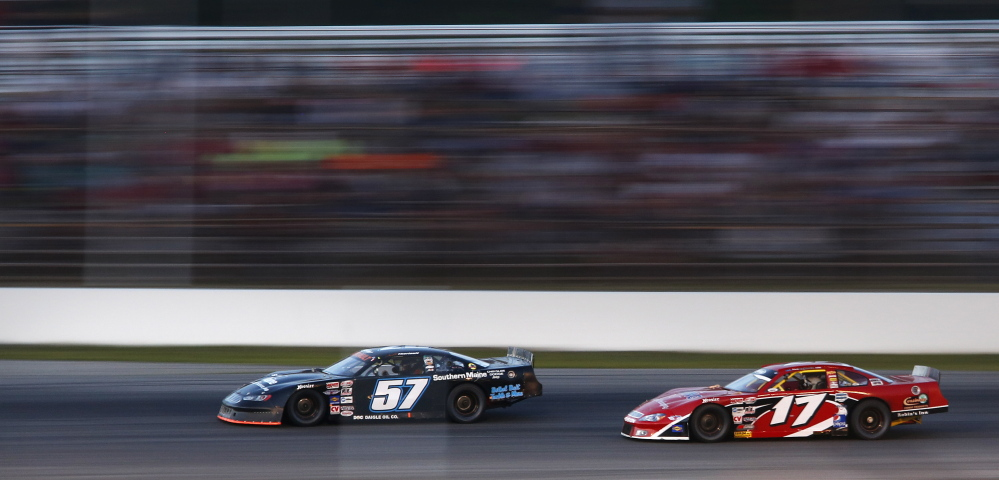 Portland Press Herald photo by Derek Davis Travis Benjamin of Morrill makes a move to pass Austin Theriault of Fort Kent on Sunday during the Oxford 250.  Benjamin won for the second consecutive year.