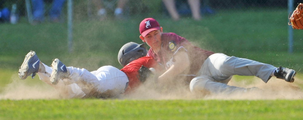 Post 51 baserunner Zach Mathieu is tagged out at second base after over-sliding the bag in the first inning in the American Legion Zone 2 championship game at Memorial Field in Skowhegan on Tuesday.
