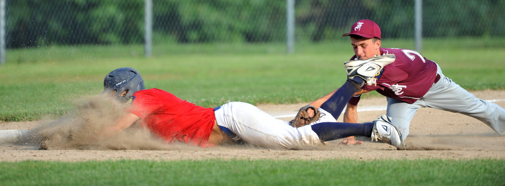 Post 51's Jake Dexter, 7, is tagged out after trying to steal 3rd base in the American Legion Zone 2 championship game at Memorial Field in Skowhegan on Tuesday.