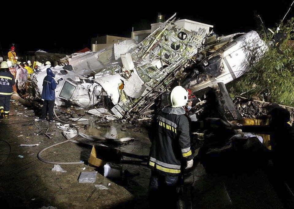 Rescue workers survey the wreckage of TransAsia Airways flight GE222 which crashed while attempting to land in stormy weather on the Taiwanese island of Penghu, late Wednesday.