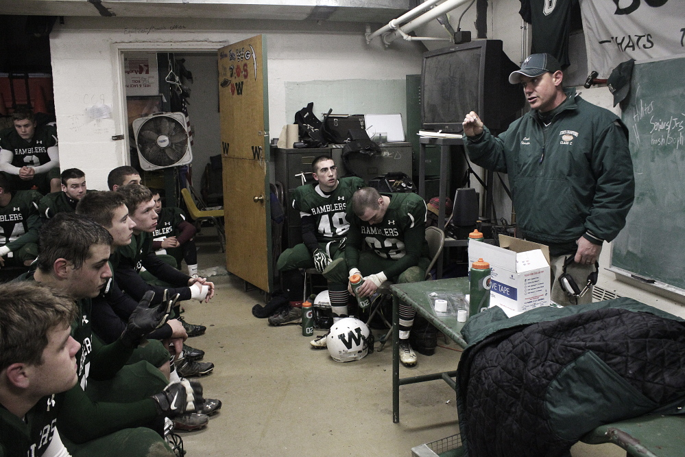 Contributed photo by Mathias Deming LEADING THE WAY: Winthrop-Monmouth coach Joel Stoneton talks to the Ramblers at halftime of their Campbell Conference playoff game against Dirigo.