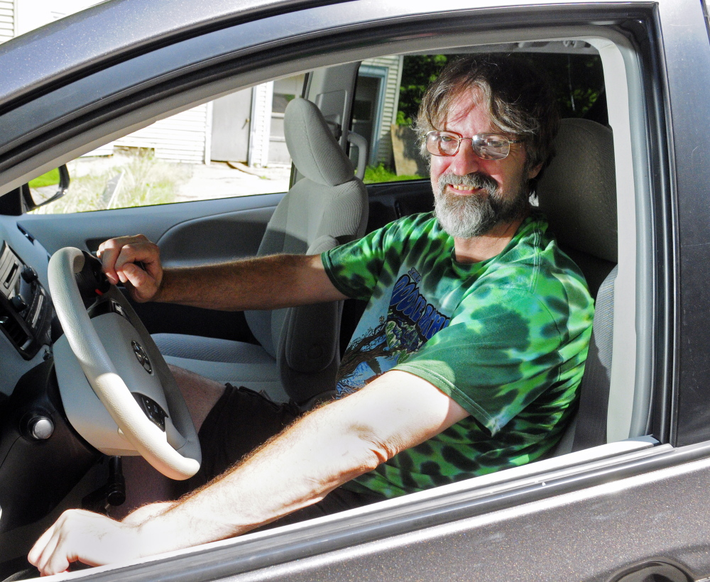 Steve Brown sits behind the wheel of his 2011 Toyota Sienna on Wednesday in Richmond. The van has a spinner steering wheel and a push right angle handle to control acceleration and stopping.