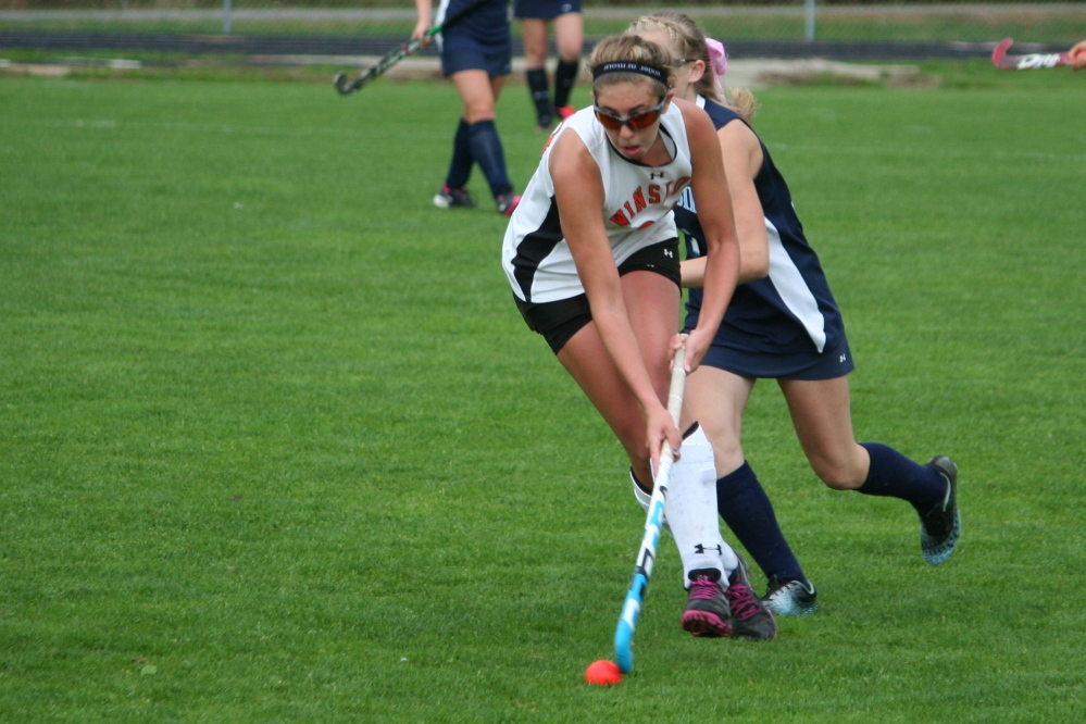 Bethany Winkin, seen here in action for Winslow High School, will play Division I field hockey at Bryant.