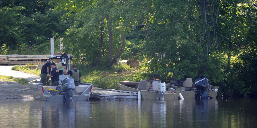 Search boats dock on the banks of the Kennebec River at the Madison boat launch on Friday. The body of Jordan Cummings was recovered at 8:55 a.m. Friday.