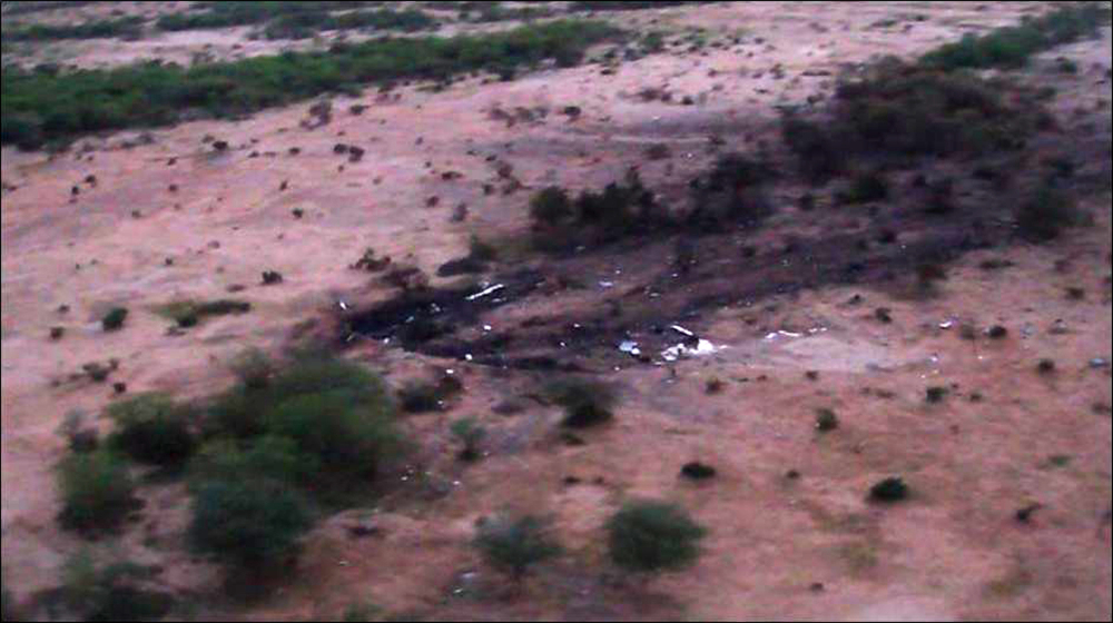 This photo provided by the French army shows the site of the plane crash in Mali on Friday. French soldiers secured a black box from the Air Algerie wreckage site in a desolate region of restive northern Mali, the French president said.