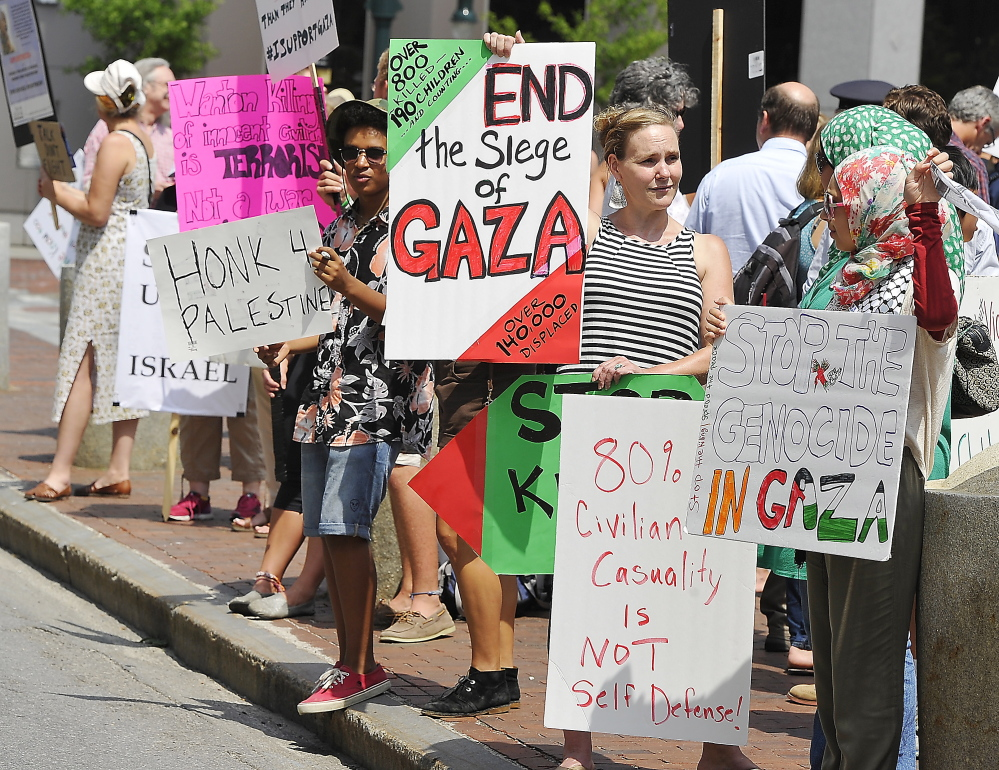 PORTLAND, ME - JULY 24: Pro-Palestinian protesters condemn Israel in a protest in Monument Square. (Photos by Gordon Chibroski/Staff Photographer)