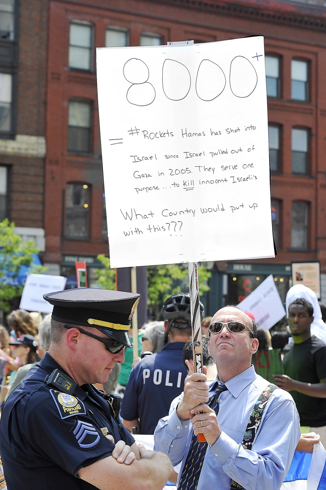 PORTLAND, ME - JULY 24: Mickey Haas of Portland was the only Israel supporter in the group as Pro-Palestinian protesters condemn Israel's response to the bombing of Israel by Hamas in a protest in Monument Square. (Photo by Gordon Chibroski/Staff Photographer)