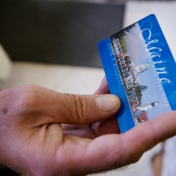 A Portland man uses a magnetic food stamp card to pay for his groceries in 2008. Gov. Paul LePage announced this week that he intends to reinstate work requirements for some Maine adults who are applying for Supplemental Nutrition Assistance Program benefits.