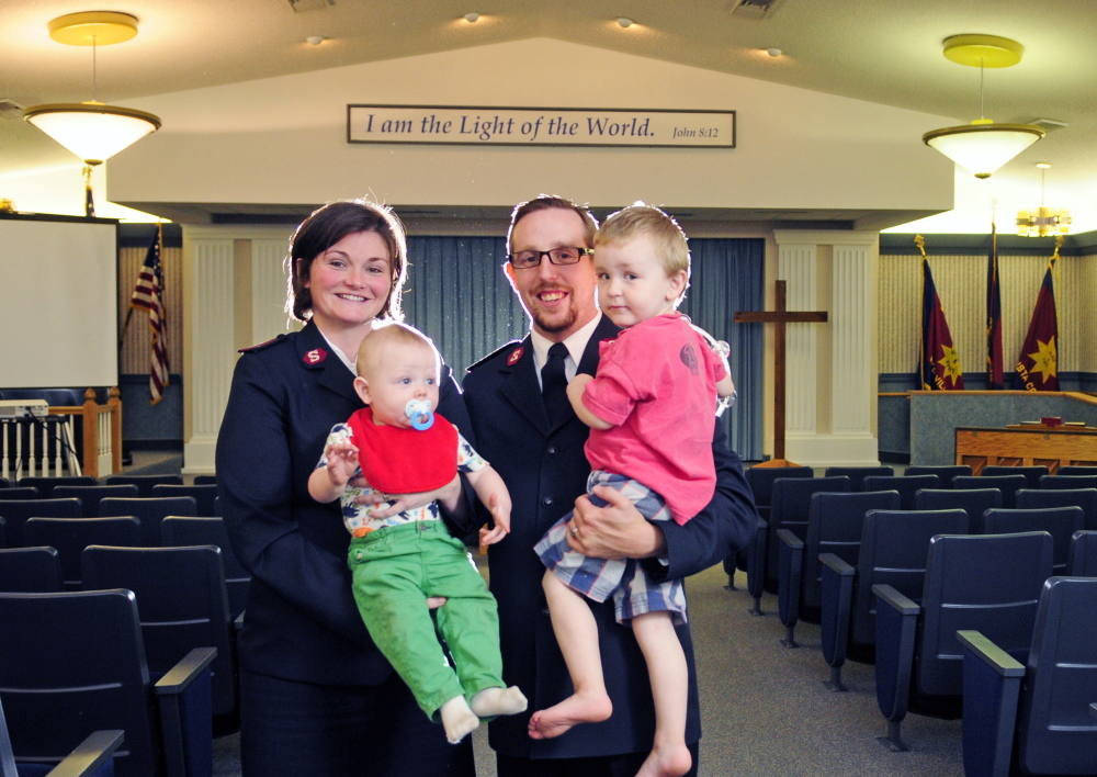 New Salvation Army officers Lt. Kama Lyle, left, and Lt. Joel Lyle pose with their children Dylan, 8 months, and Jordan, 2, on Thursday in Augusta.